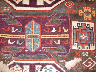 Lenkoran design Kazak? fragment. Top notch color including a perfect grape purple. The blue-grey ground is rare and a great backdrop for such boldly drawn and colored ornament. Dynamic drawing with Memling  ...