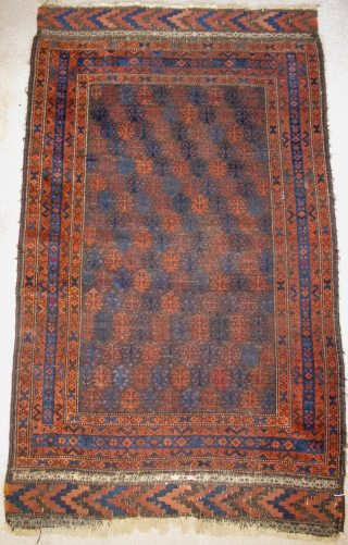 Baluch Rug with shrub pattern field, a few animals too. The way the blue border breaks is a nice feature rarely encountered. A few highlights with cochineal, good weave in good shape  ...