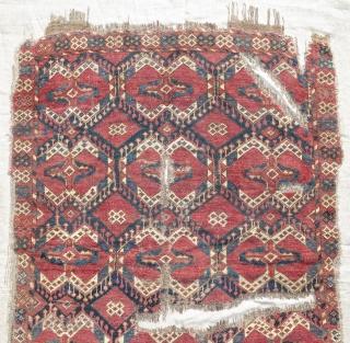 Ersari or Uzbek rug with an ikat (ak kymak) design. Fragmented, mounted, and conserved.