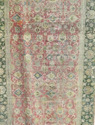 Indo-Isfahan Carpet, second half of the 17th century. Worn and with scattered repairs but complete. Apx. 8'x18'
