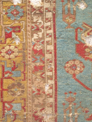 Ladik Prayer Rug, late 18th century, severely fragmented in two sections, dynamic drawing with many stylized ewers, very dirty and damaged but with a vibrant and uncommon gold border, recently found in  ...