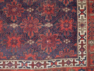 Elegant Antique Baluch Main Carpet with snow-flake blossoms in lattice design and minakhani border. Deep saturated natural colors with corrosive brown and masterful use of white. Boucher attributed rugs of this type  ...