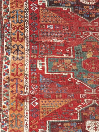 East Anatolian Kurdish rug with saturated madder-red ground and matching red weft. Great color with green, sky-blue, golds and ox-blood. Several condition issues but complete, readable, and radiant. Great wool too.