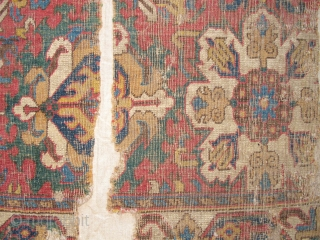 "Caucasian Blossom Carpet Fragment, excellent drawing and colors, 17th/ early 18th century. This is the top left-hand corner of the carpet. It is photographed here upside-down. Mounted and conserved. 41""x61"" / 104x163cm  ..."
