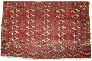 """Tekke Chuval, very fine and thin with silk highlights throughout. Multiple (30) mafrash gul field with abstract tree pattern elem. Certainly old enough. size is 43""""x28"""" / 109cx72cm"""