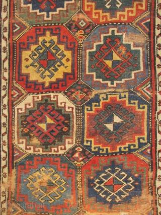 Northwest Persian Kurdish rug with a star border  and 'Memling gul'design