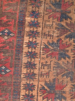 Baluch animals and tree rug on a camel ground. Several bues including a slightly corossive grey-silver blue. Very nice drawing with a border of ten-pointed and eight-pointed stars.