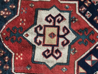 exquisite Fachralo Kazak.Seems to be clearly older than these late workshop copies. Complete, untouched, some damages. Restauration can be discussed. Great colors