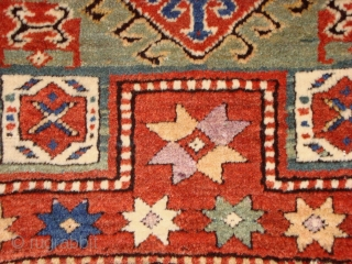 East Anatolien carprt? 1,26x1,22m high pile,shine wool,a little mauvin in two stars in the border. Made about 1900 or beginnin 20th cent.