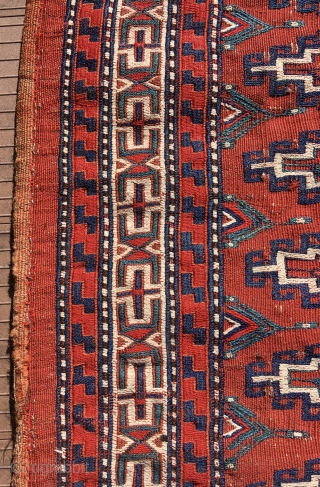 """Yomut chuval, complete with red plainweave back. Flatweave with Memling-gul design in sumac and other weft-wrapping.  49"""" wide by 30"""" deep (125 cm x 76 cm).  Overall condition very good.  ..."""