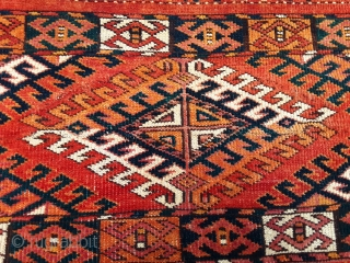 """Antique Turkoman torba, most likely of Arabatchi origin, given the characteristic elem, decorated with ten """" Kelle figures"""" and its soft clear orange red as field color About 1850, natural colors and in  ..."""