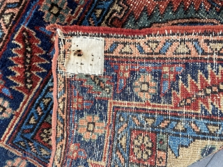 """Heriz small rug - about 55"""" x 31"""".  Overall scatter wear with machine surged ends."""