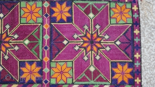 Antique Uzbek cross stitches embroidery. Beautiful colours and stitches. Good condition. The size is: 26cm X 26cm. Offered reasonable price.