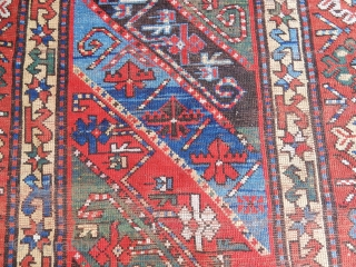 DECORATIVE KAZAK/GENJE CARPET WITH GOOD SIDES AND A BIT OF END LOSS - SIZE IS    4 FT X 9  1/2 FT -   PRICE - $700