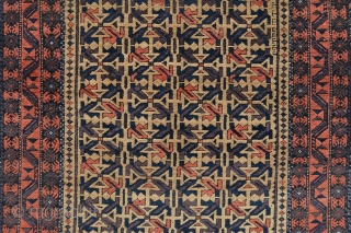 "Baluch rug with camel-hair field in very good condition bar an expert repair to one of the plain-weave chevrons - 1.82m x 0.97m (6' 0"" x 3' 2"").