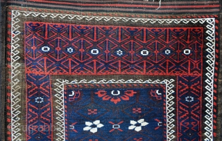 This is a beautiful early Baluch rug of the Sabzevar type with the usual heavy brown-dye corrosion but with superb glowing blues and reds. The brocaded skirts remain and the mina-khani design  ...