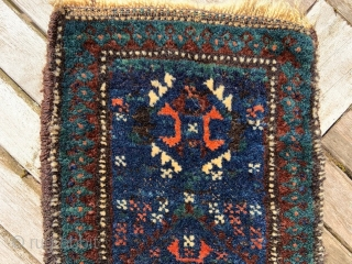 Rare and  beautiful 19th century Timuri namakdan with deep indigo-blue field and a wonderful use of green in the outer  'medakhyl' border. The bag is complete, knotted on both faces  ...