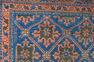 Unusual small, narrow size Baluch with 'snowflake' field design and with piled chevron skirts each end. Very good condition with the usual dark-brown dye corrosion within the 'snowflakes'. - 1.82m x 0.86m  ...