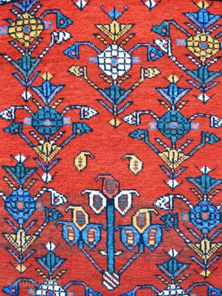Charming small Luri rug with warm madder-red field in excellent condition.