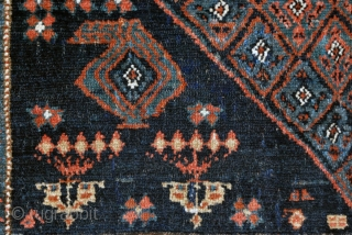 "Sonqor Kurdish with a bold border and quite a tribal character. Ca. 1920, 136 x 160 cm. (4'6"" x 5'4""). This rug with its squarish size and concentric design could have been  ..."
