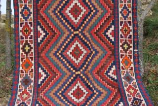 Caucasian kilim. Cm 200x320. Late 19th/early 20th century. Wonderful colors, except for some suspicious orange. Some minor corrosion on brown. Several pile dileks/wishes. In very good condition. See more pics on Facebook: