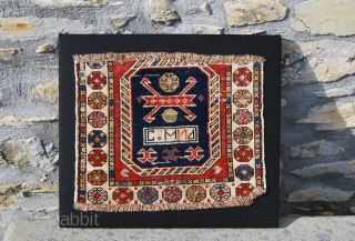 """Kuba? horsebag  fragment. Professionaly mounted. Cm 42x44. Beautiful & decorative. The writing means: """"Selim"""", the name of the weaver, or?... See mor epics on fb: https://www.facebook.com/media/set/?set=a.10151350219608492.481422.579403491&type=1&comment_id=25222382&notif_t=photo_album_comment See more postings on RR: http://rugrabbit.com/profile/580 Have you seen  ..."""