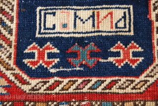 "Kuba? horsebag  fragment. Professionaly mounted. Cm 42x44. Beautiful & decorative. The writing means: ""Selim"", the name of the weaver, or?...