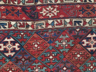 Shahsavan/Khamseh sumack saddle bag face. Cm 48x65. End 19th c. Great saturated colors. Very interesting diamond lattice main field with a repeating cruciform motif. Three, probably even more interesting borders with stylized  ...