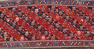 """Mogan Shahsavan Sumakh Side Panel fragment. Cm 59x106. End 19th century. Beautiful moharamat pattern with diagonal stripes, 7 indigo blue, 7 madder red, with 126 flowers and 53 """"windows""""in the outer long  ..."""