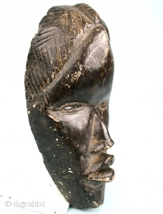 "Stone carved Dan/Ivory Coast-Liberia  mask. Second half 20t c. Cm 20x12x6,5. Weight 1kg/2pounds ca. Great carving quality.  Seems a ""runners mask"", while masks like this one are sacred and not  ..."
