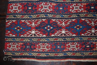 Beautiful Caucasian, Karabagh? sumack mafrash side panel. Cm 40x98 ca. Datable to the 3rd or 4th quarter of the 19th century. Main pattern with complete cruciform motif alternated with opposite halve ones.  ...