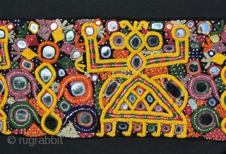 Rabari nomads shawl end from North-Western India. Heavily embroidered with lots of small mirrors to ward off evil eye. Cm 15x92, framed cm 25x100. A lovely decorative tribal jewel.