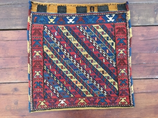 Shahsavan sumack khorjin bag with original back. Cm 60x60 ca. End 19th century. Great colors, great weaving details. A very beautiful bag, with a rough, primitive weave and crisp colours. In very  ...