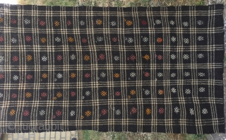 "Goat hair kilim. Cm 113x243. Early to mid 20th century. Eastern Anatolia. Black & white checkered pattern with over hundred embroidered ""guls"". See description in here: http://rugrabbit.com/node/167998"