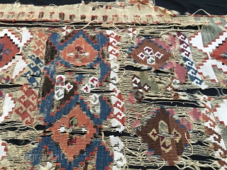Ageless textile wreck. Cm 76x246. Early 19th c or even earlier, so, well over 200 years old. Eastern Anatolia kilim strip fragment. A real wreck, but still fascinating. Any textile archeologist out  ...