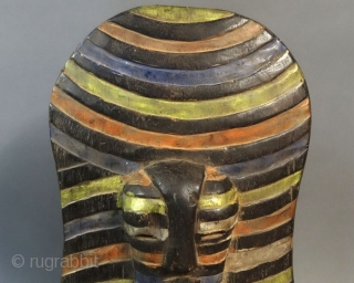 Africa, Congo, Songye tribal group war and dance ceremonial wooden shield. Cm 25x50 ca. Mid 20th. c. With front mask. Polychromatic. In good cond.