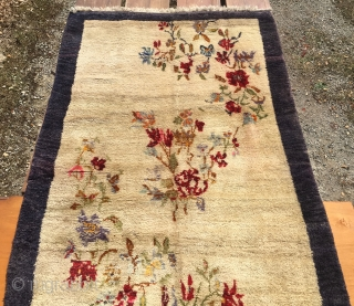 Flower vintage yatak or sleeping rug. Cm 140x240 ca. Datable 1920/1940. Central Anatolia, could be Karapinar. Very high pile. Beige field with blueish border. Condition issues: a couple of small moth holes  ...