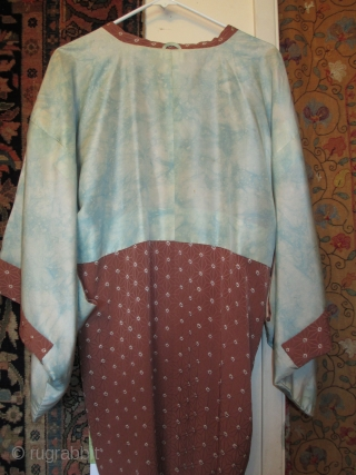 Antique silk haori (jacket). Striking complementary patterns in color and design. Gorgeous as a wall hanging; with a little stitching to snaps can be worn. Jacket is reversible! Some scattered small stains.  ...