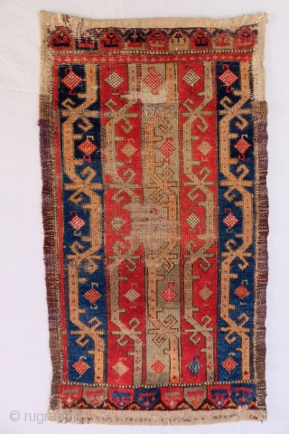 Anatolian Yastik Size: 94x52 cm, 3ft.1in. x 1ft.8in.  Condition: Complete, Areas of low pile, some reweaves in the field. Corroded green. The red probably synthetic.