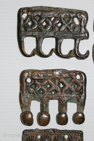 A rare 18 piece group of ancient Tibetan bronze Tokcha armour plates. They appear to be from several different sets. The largest pieces are 82 x 72 mm. and the smallest are  ...
