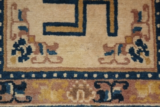 A 19th century ceremonial seating rug. Ningxia, China. 22 x 23 inches.