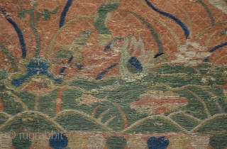 A Ming dynasty sutra cover. Silk embroidered on a gauze ground with design of fish and ducks in a pond with cranes in the sky. The bottom border is hanging jewels and  ...