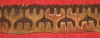Central Asian wool tapestry fragment. 2.5  x 30 inches. Both sides have the original selvedge. The design is a row of reciprocal antlers, probably denoting a clan symbol. Approximately 2000 years  ...