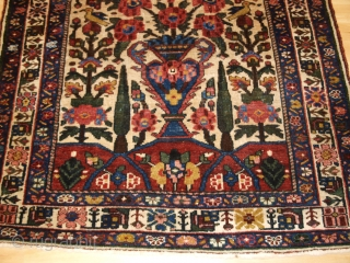 Antique Persian Bakhtiari rug of the garden design with a large vase. www.knightsantiques.co.uk 