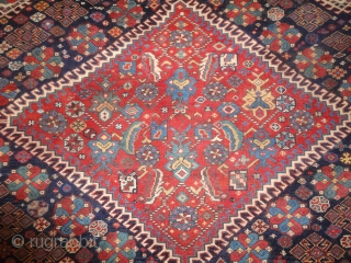 Antique South West Persian Qashqai rug, with triple latch hook medallion design, outstanding drawing and colour. The medallion is surrounded by a field filled with floral rosettes and tribal design elements. Note  ...