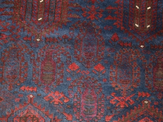 Antique Afghan Timuri Baluch rug from Western Afghanistan. www.knightsantiques.co.uk  Size: 8ft 0in x 4ft 11in (245 x 151cm).   Circa 1880.  A good Timuri Baluch rug from Western Afghanistan, with very dark indigo blue  ...