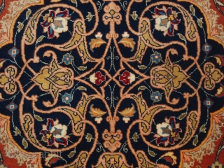 Antique Persian Sarouk rug of classic small medallion design, with floral sprays on an terracotta red ground. www.knightsantiques.co.uk 