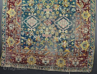 A beautiful Agra rug in horrible condition! Fabulous ground colour and drawing that is reminiscent of much earlier weaving. Mid-19th century. 197x120cm