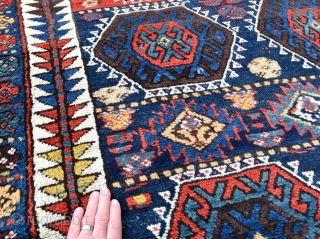 An antique Sinjabi Kurdish rug from North West Persia. A beautiful tribal rug with glowing natural dyes and good wool. Both decorative and collectable, this wonderful old rug is in exceptional condition  ...