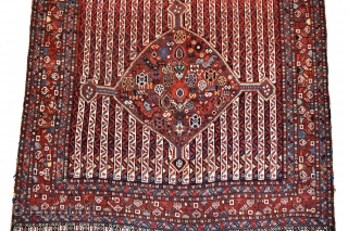 An antique South West Persian Khamseh tribal rug. 2 medallions filled with chickens and other filler elements float on a rare cane stripe ground. All natural dyes, all wool construction. A genuine  ...